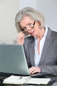 Senior businesswoman with eyeglasses working in the office